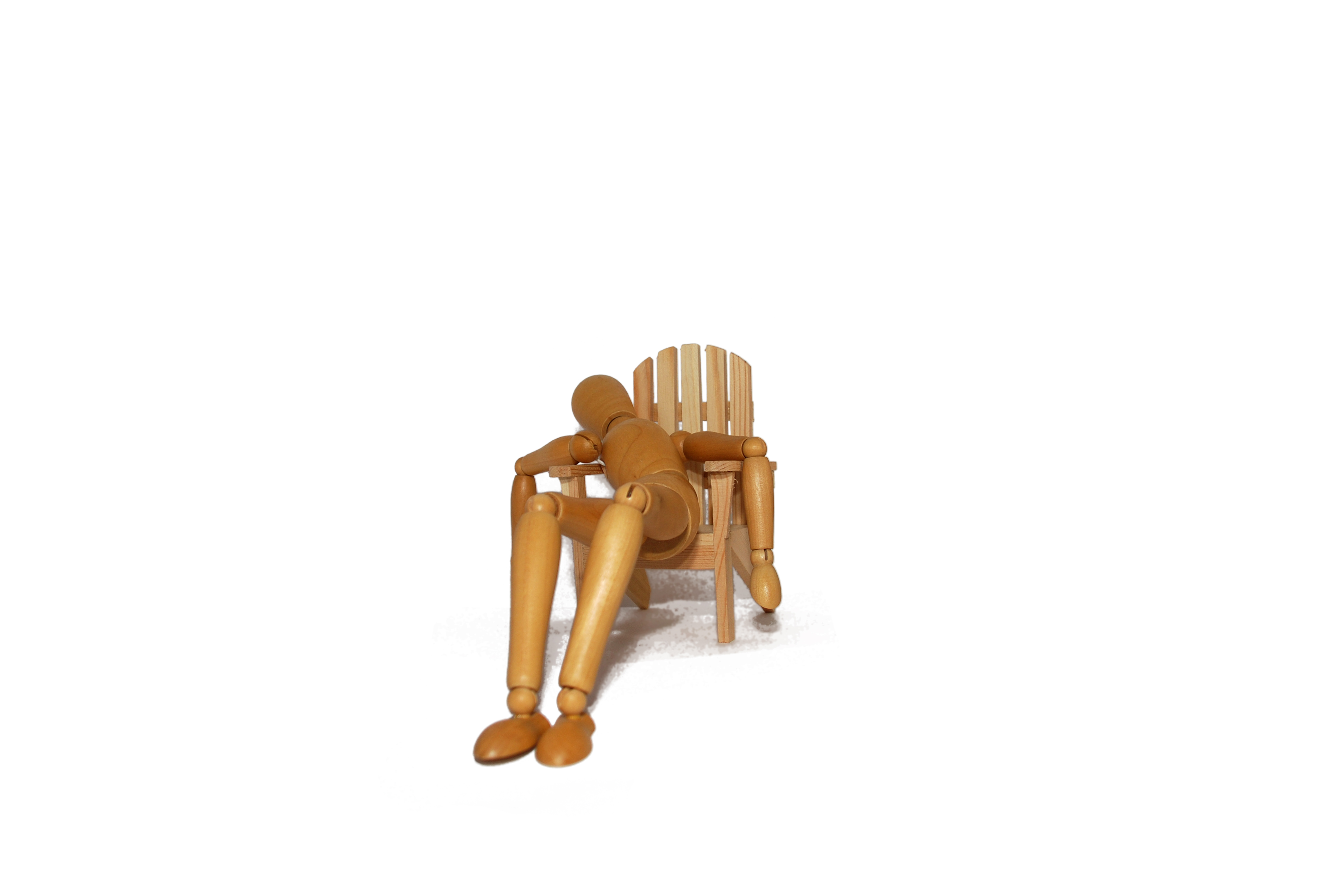 Wooden figure collapsed in a chair